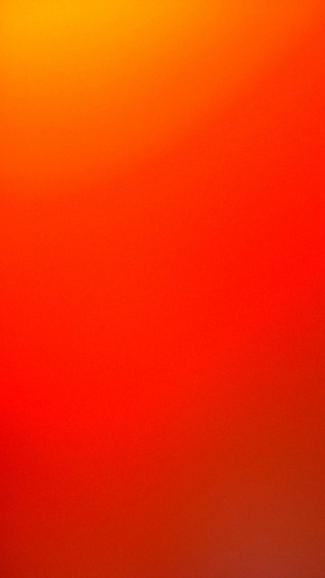 iOS 7 Official Bright Orange Android Wallpaper download 360x640