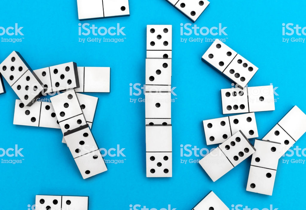 Dominos Pieces On A Blue Background Top View Stock Photo 1024x703