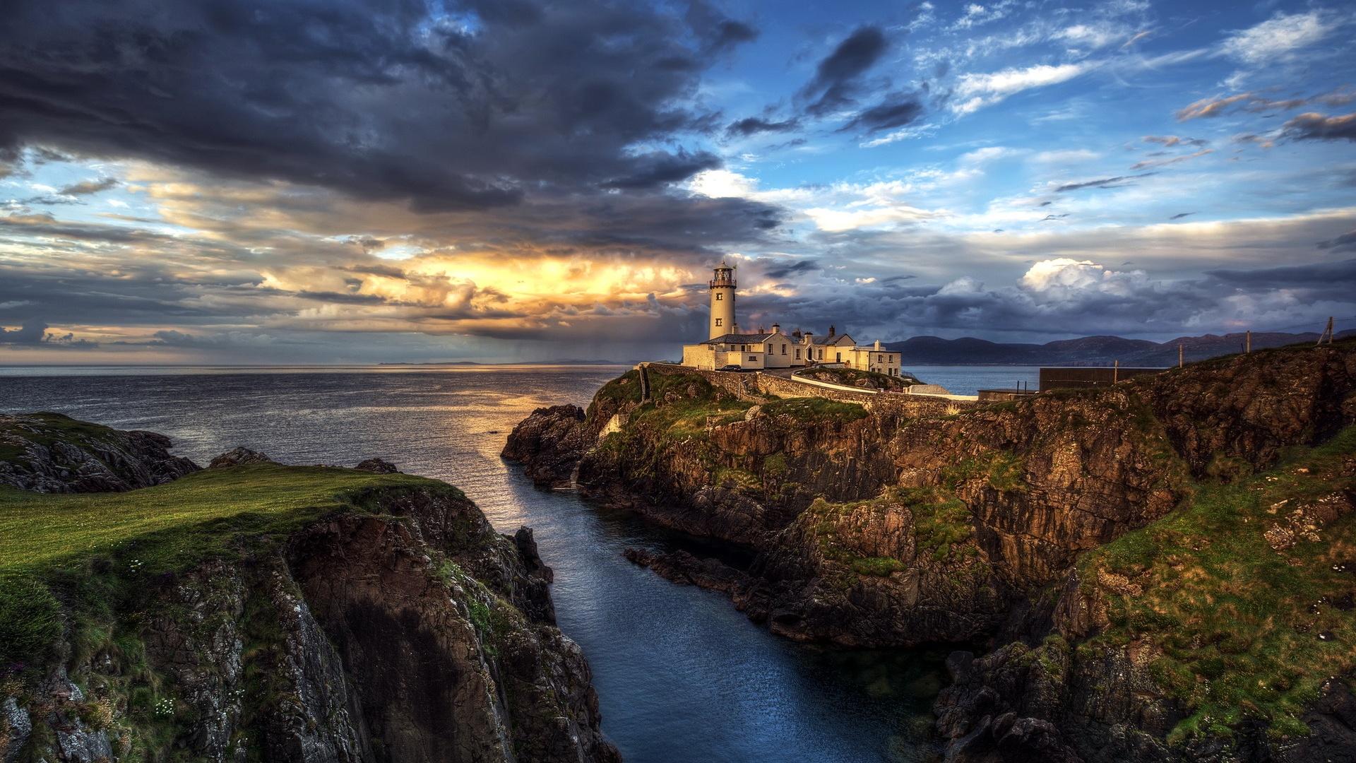 Ireland lighthouse ocean seascape sunset clouds Wallpaper Widescreen 1920x1080