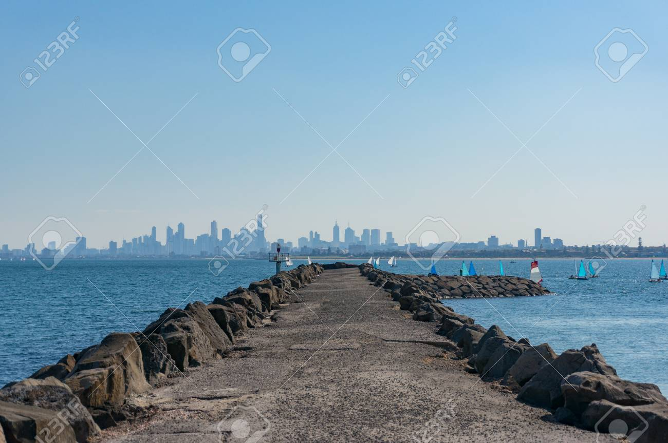 Long Pier Jetty With Sailing Boats And Modern Cityscape On The 1300x863