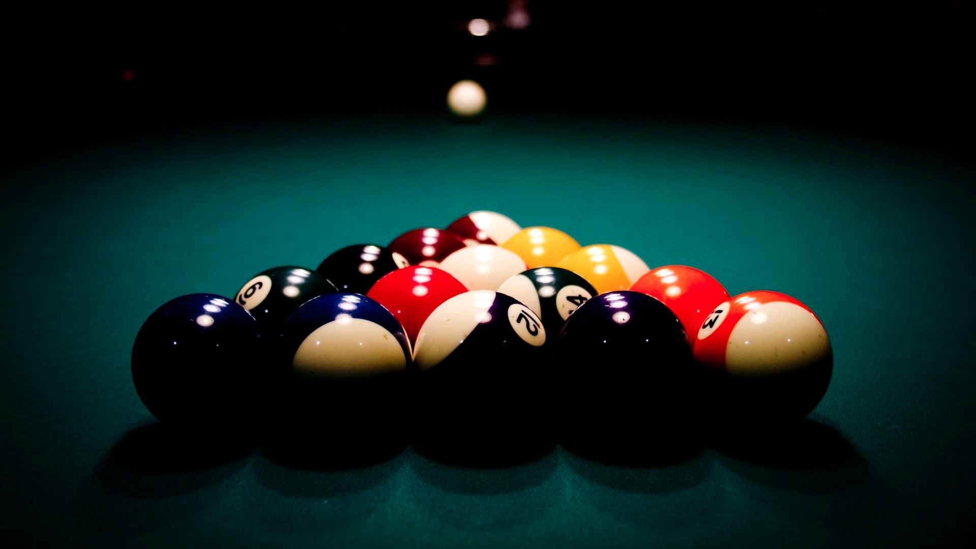 a description of billiards a game played on a rectangular table half as wide as it is long