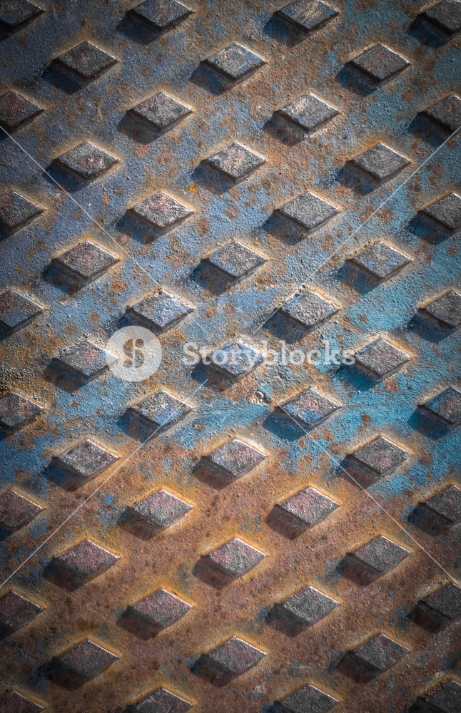 Old rusty drain cover background with diamond pattern Royalty 646x1000