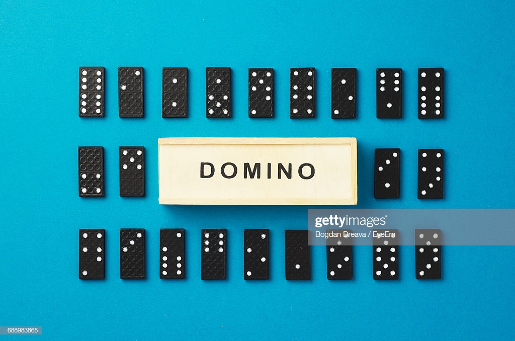 Text Amidst Dominos Arranged On Blue Background High Res Stock 1024x678