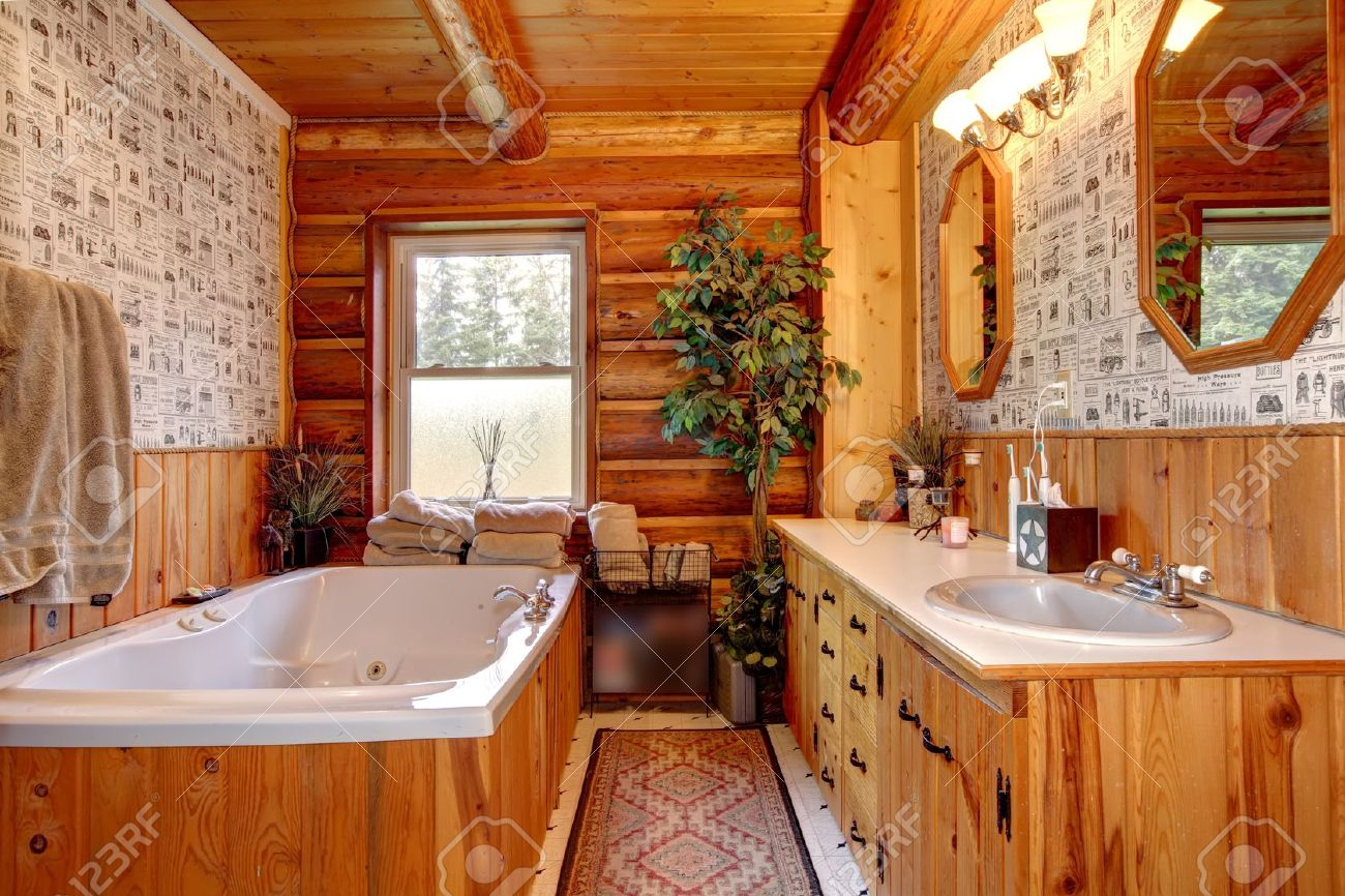 WOod Cabin Bathroom With Tub And Wallpaper Stock Photo Picture 1300x866