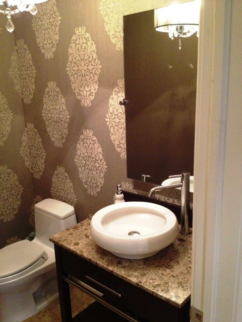 Dramatic oversized wallpaper has impact in this tiny powder room 480x640