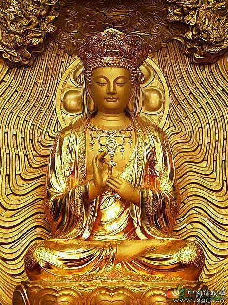 The Buddha with his hand in the teaching mudra 467x624