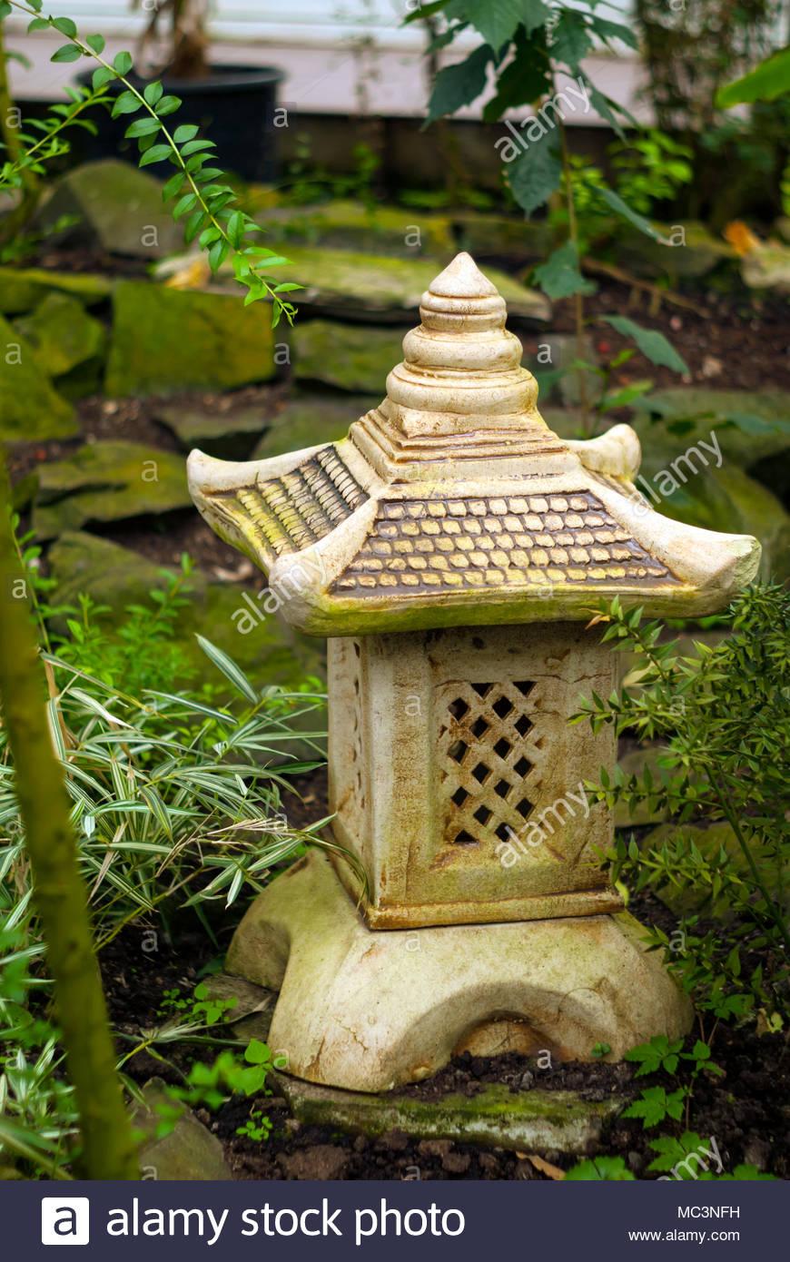 decorative garden lantern toro in Japanese style on the background 870x1390