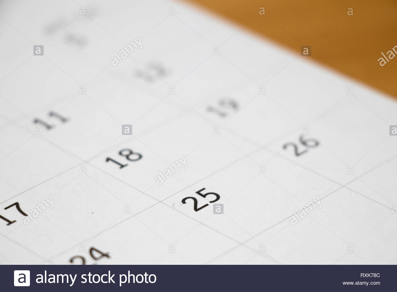 Closed up of day 25 on calendar background Stock Photo 240138652 1300x956