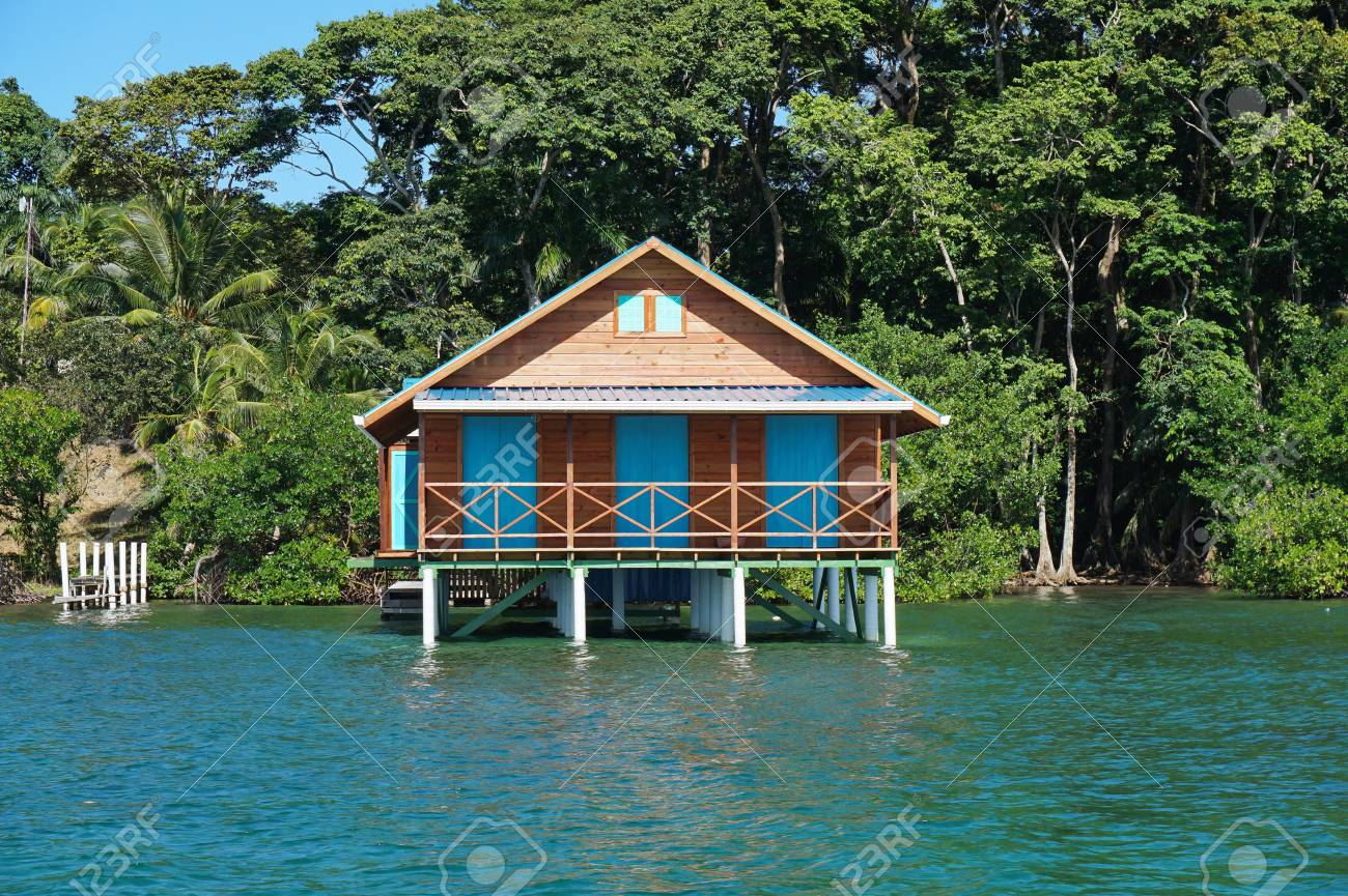 Bungalow Over Water With Tropical Vegetation In Background 1300x865