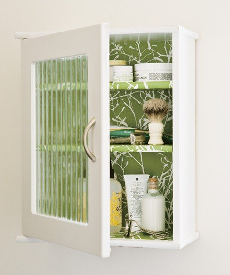 medicine cabinet with reeded glass door and wallpapered interior 475x567