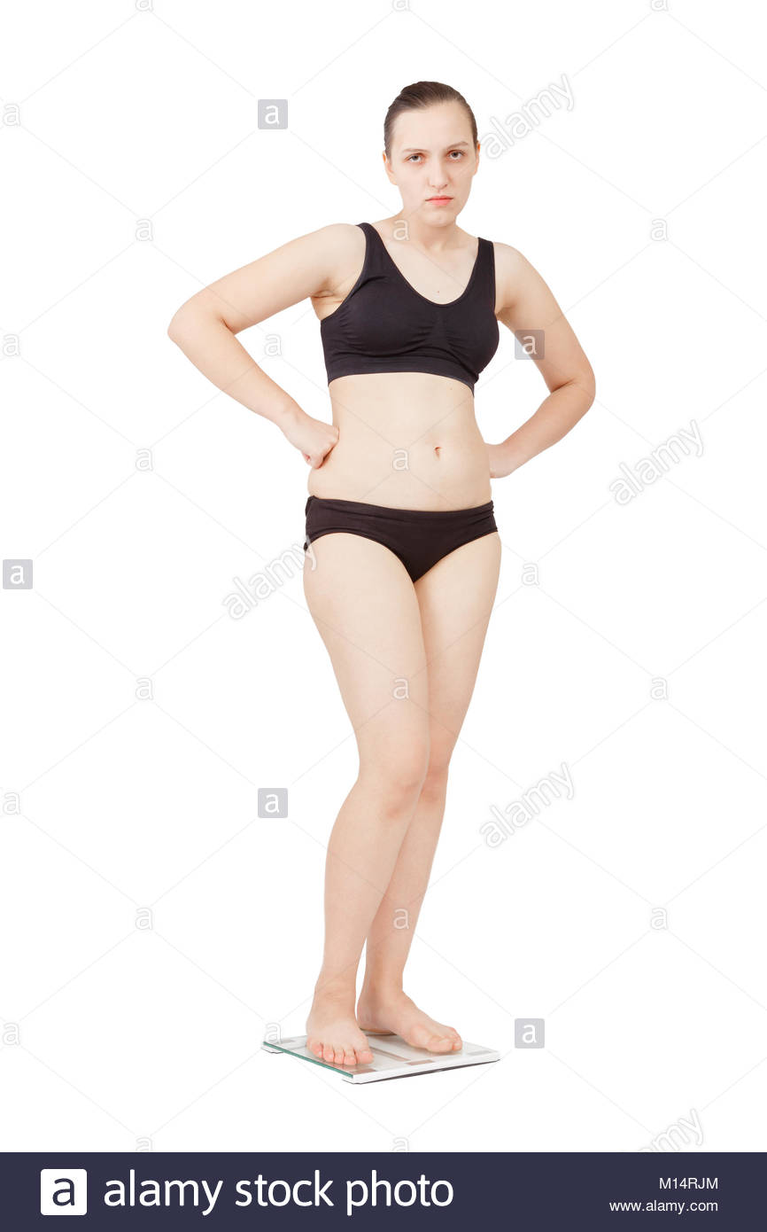 sad thick overweight woman on scales isolated over white 866x1390