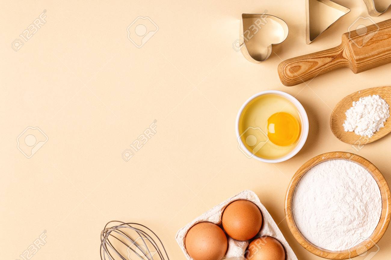 Ingredients And Utensils For Baking On A Pastel Background Top 1300x866