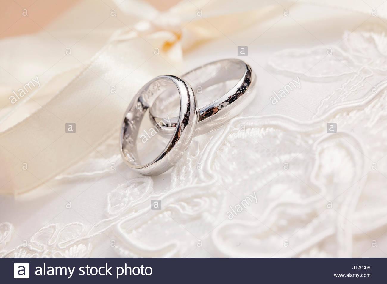 Wedding rings on beautiful background Stock Photo 152663625   Alamy 1300x956