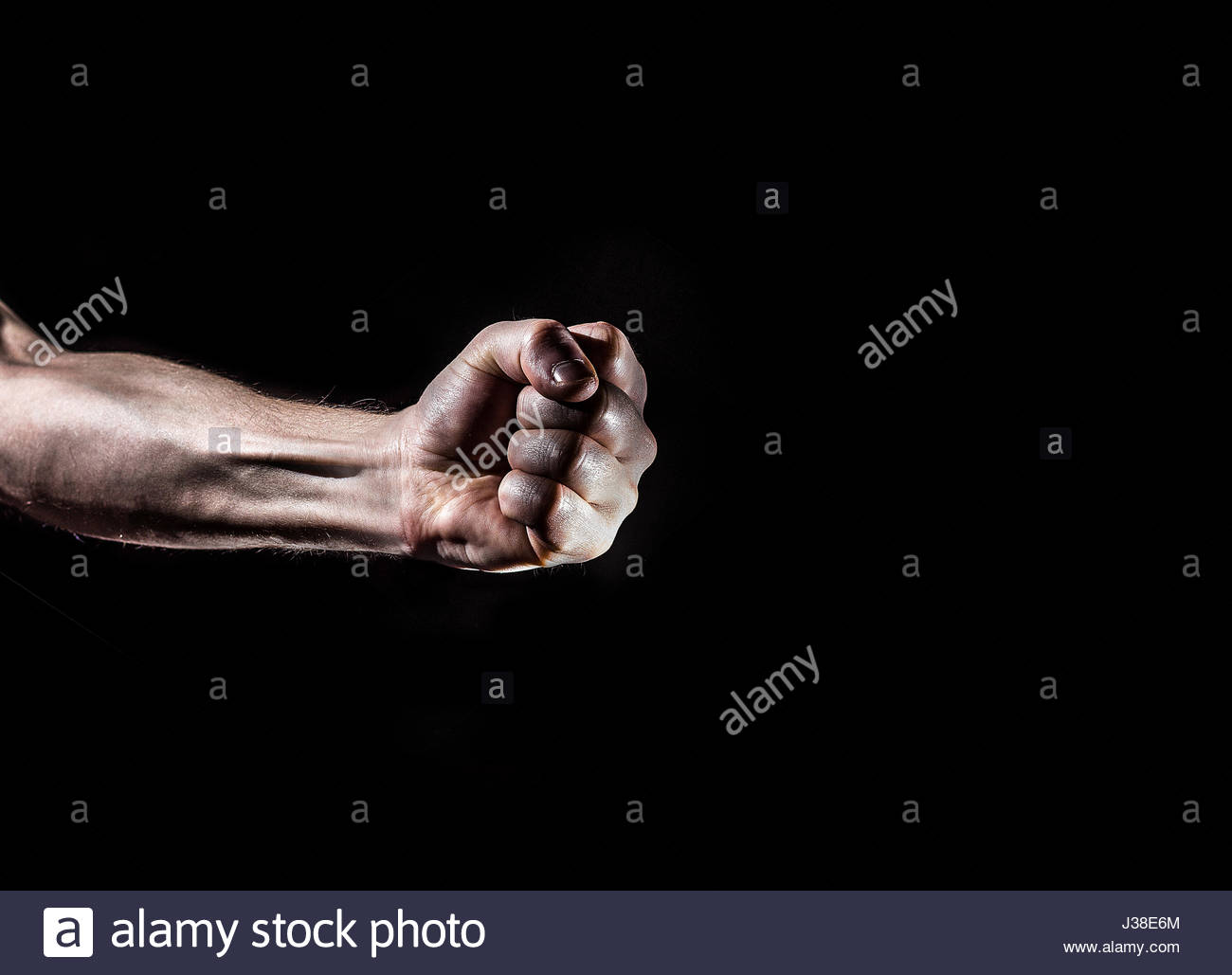strong male man raised fist on a black background power protest 1300x1029