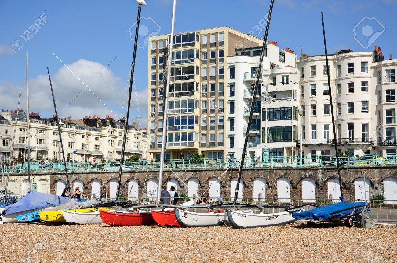Colourful Yachts On Brighton Beach  buildings In The Background 1300x863