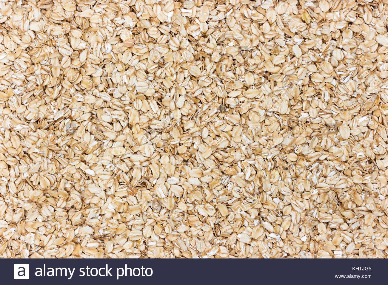 Oatmeal background Oat flakes texture Stock Photo 165883877   Alamy 1300x956
