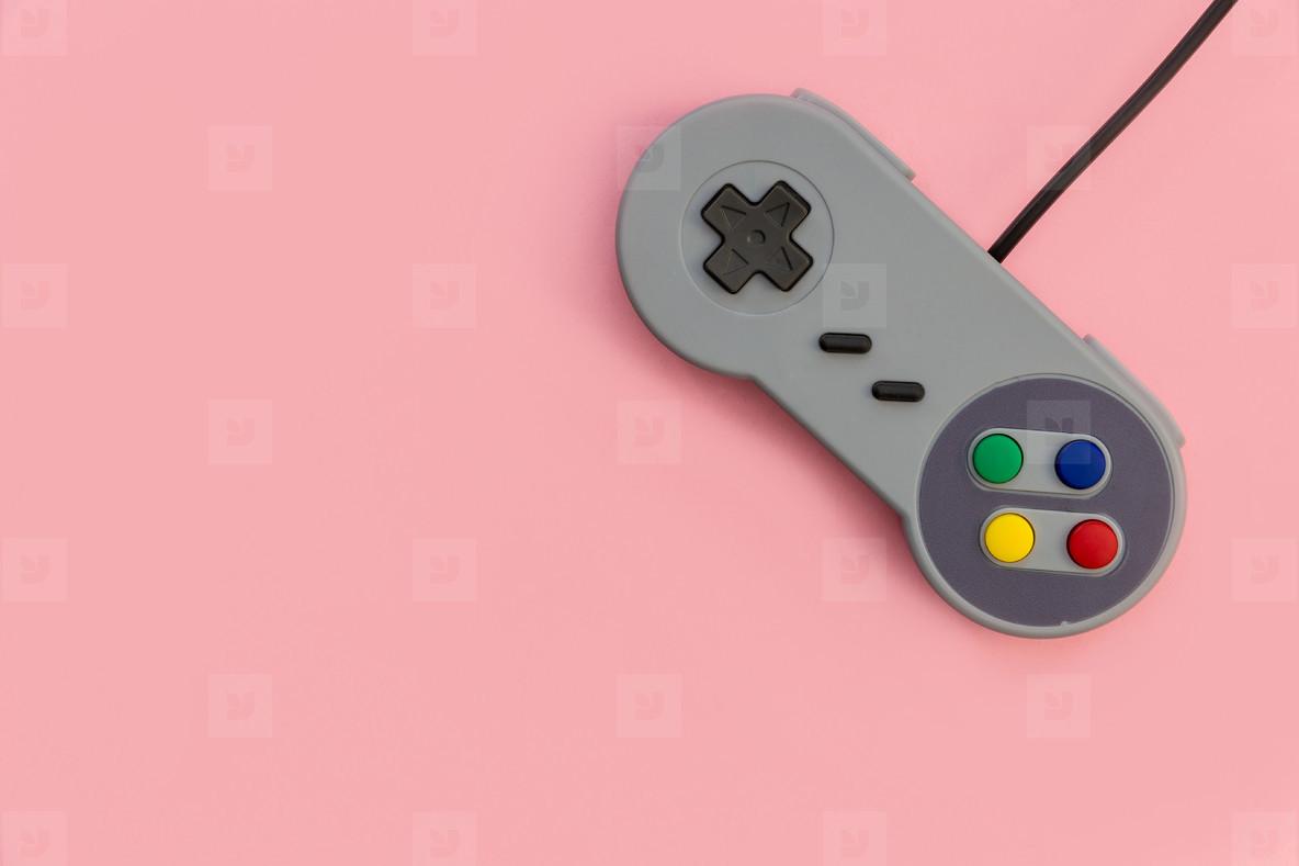 Photos   Retro video game controller pink background   YouWorkForThem 1184x789