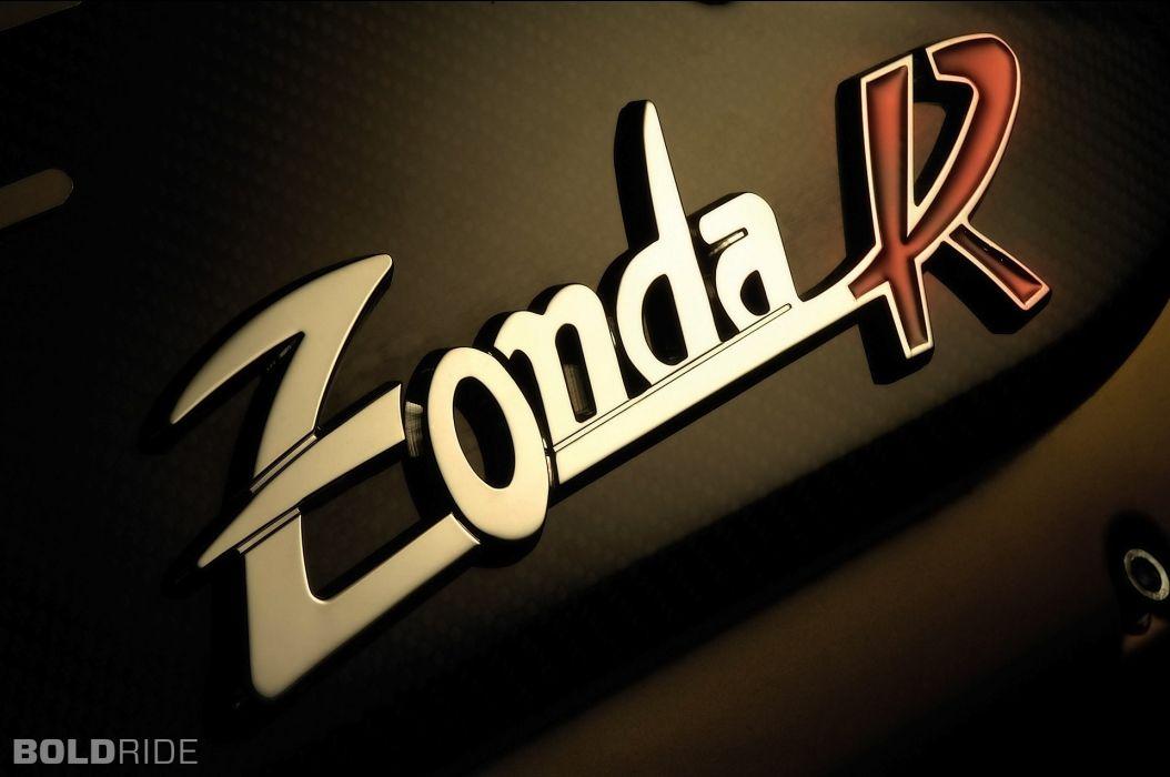 2009 Pagani Zonda R supercar supercars logo texts wallpaper 1054x700