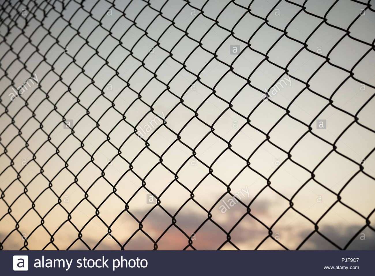 Sky through wire mesh fence Blur background close up view of 1300x956