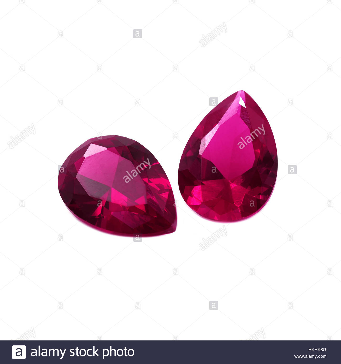 Pear Shape Diamond Cut Rubies on a White Background Stock Photo 1300x1390