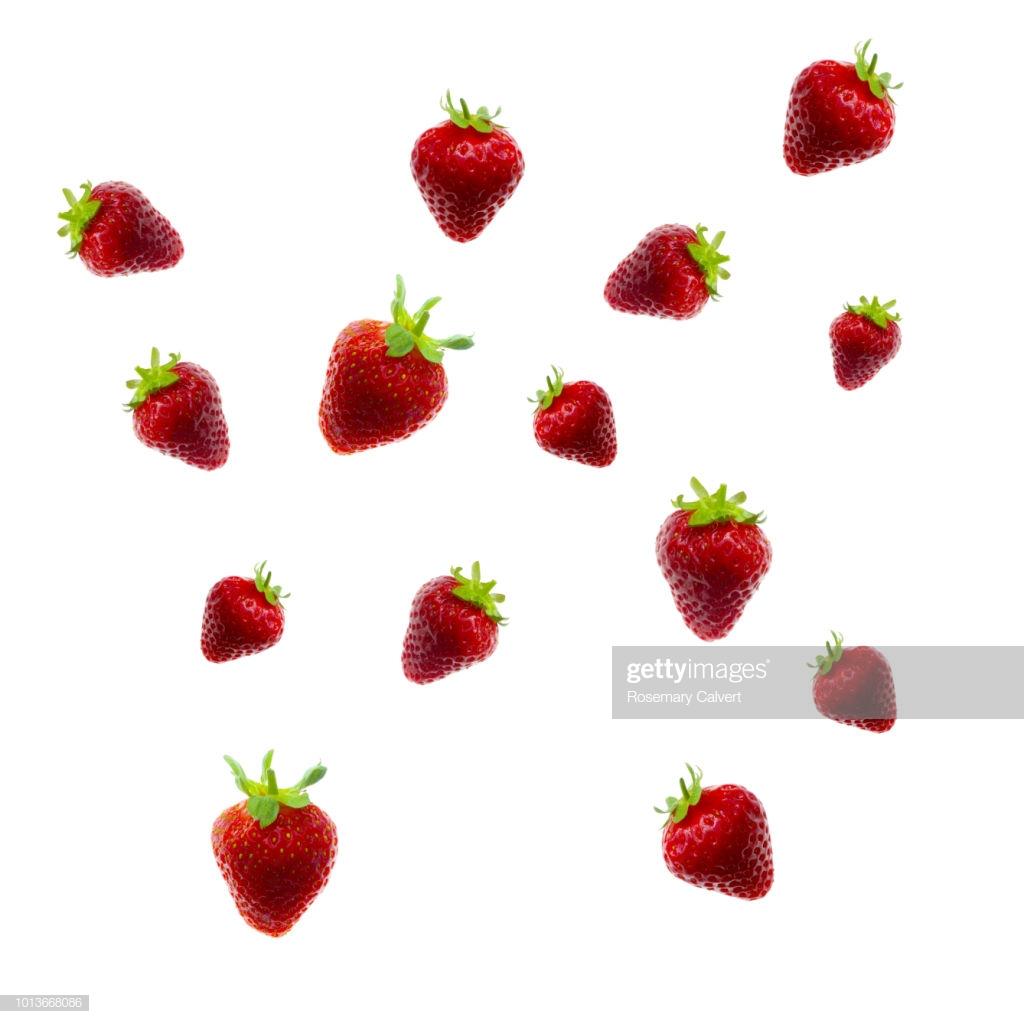 Strawberries Tumbling Across White Background High Res Stock Photo 1024x1024