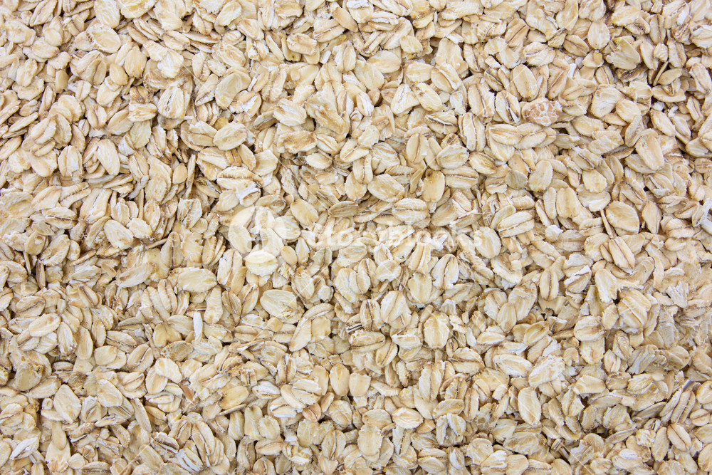 Top view of oatmeal flakes in close up as a background or full 1000x667