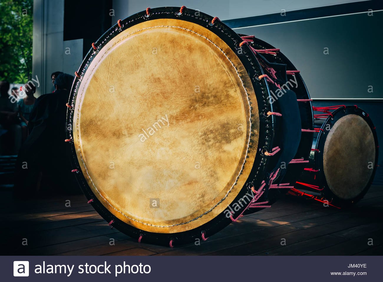 Double headed drum Taiko drums o kedo on scene background Musical 1300x956