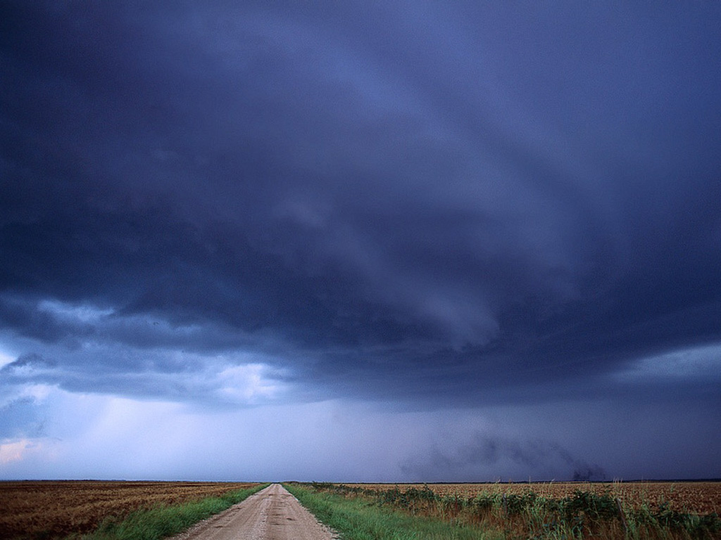 Heavy Clouds Hanging Over A Road And Field   Weather Wallpaper Image 1024x768