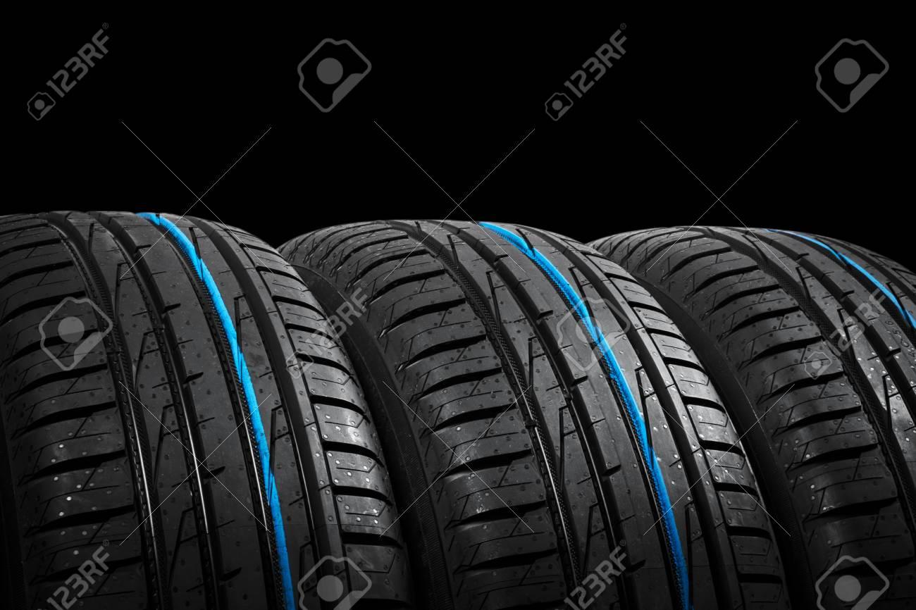 Studio Shot Of A Set Of Summer Car Tires On Black Background 1300x866