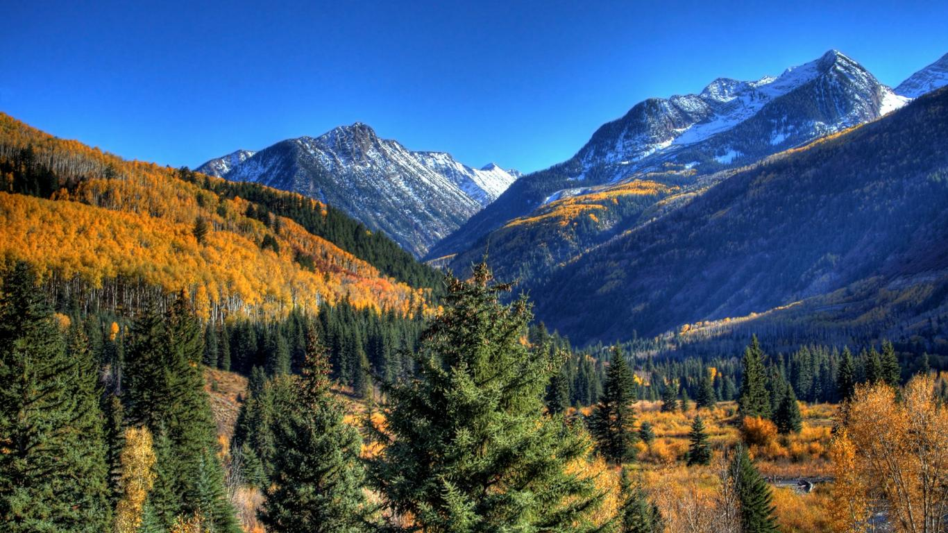 green mountains nature autumn yellow evergreen skyscapes HD Wallpaper 1366x768