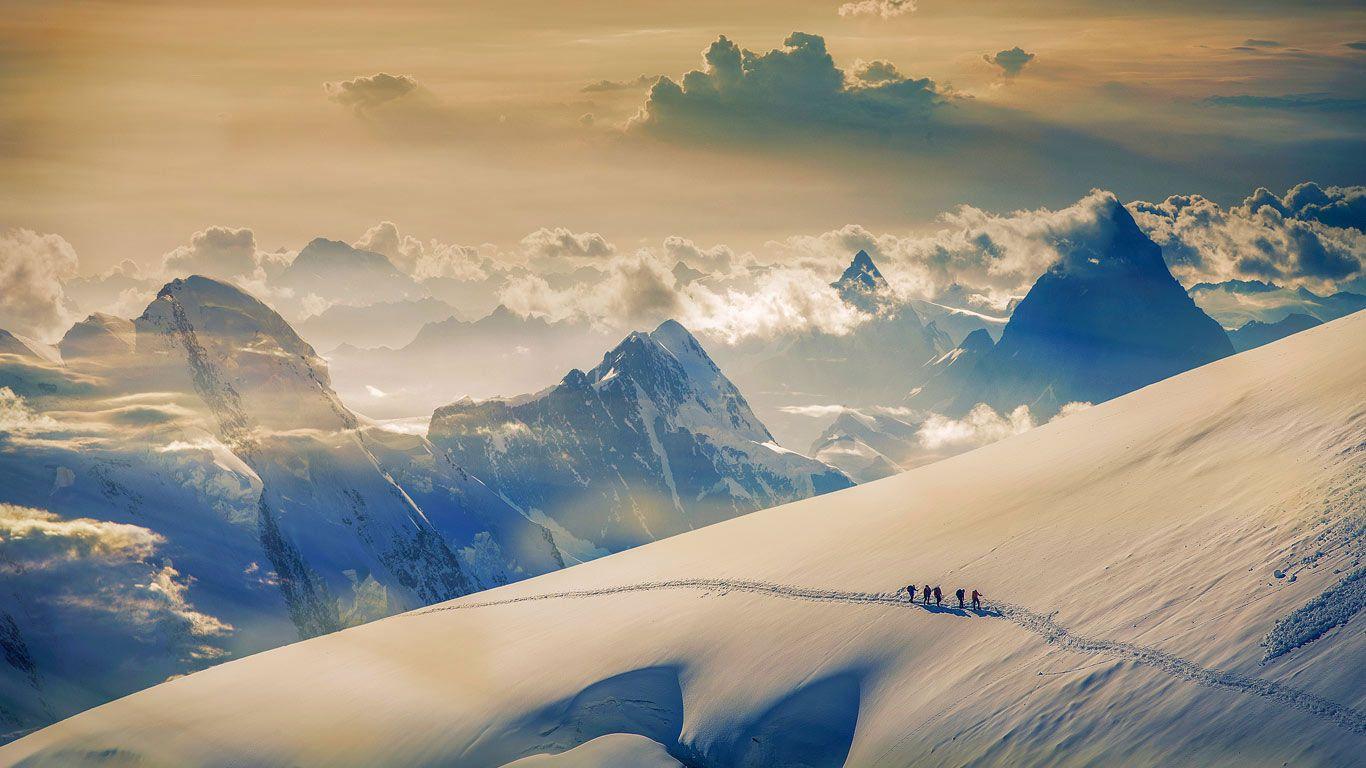 Climbers ascending Jungfrau in the Bernese Alps Switzerland 1366x768