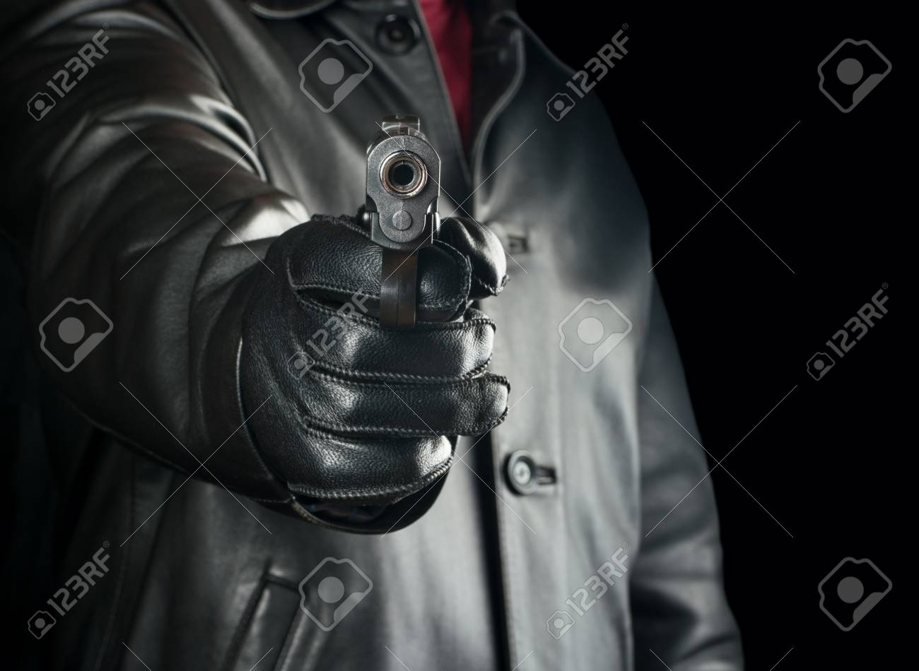 Bandit Directs Gun On Black Background Closeup Stock Photo 1300x950