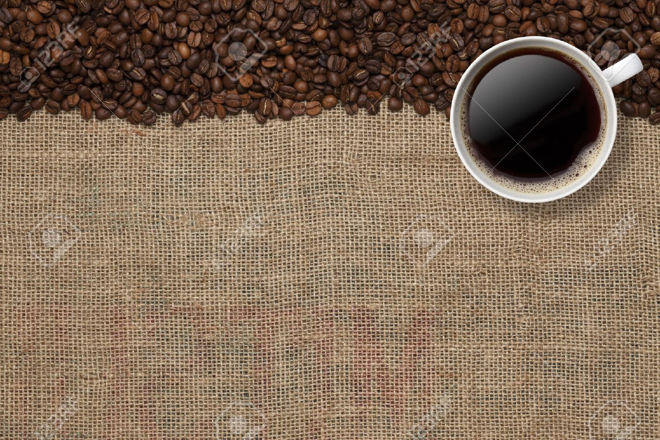 Coffee Beans And Coffee Cup On A Jute Background Stock Photo 1300x866
