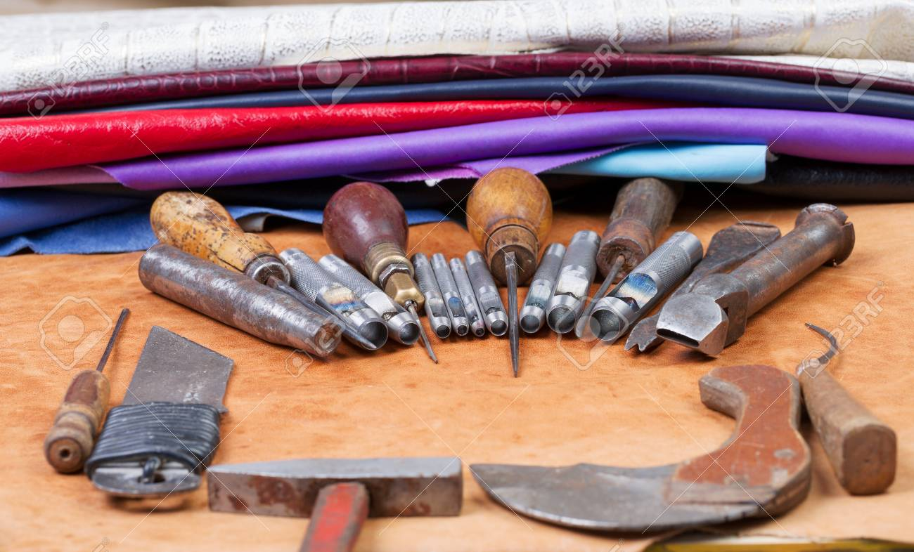 Leather Craft Tools On A Leather Background Craftsman Work Desk 1300x786