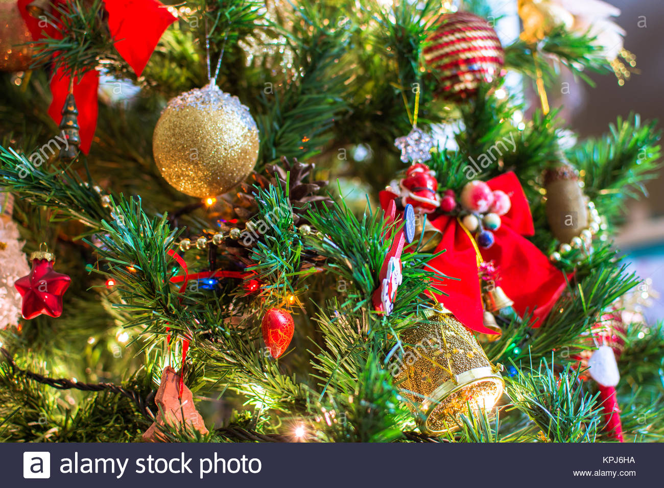 Jingle bell Christmas tree branches with blurred background Stock 1300x956