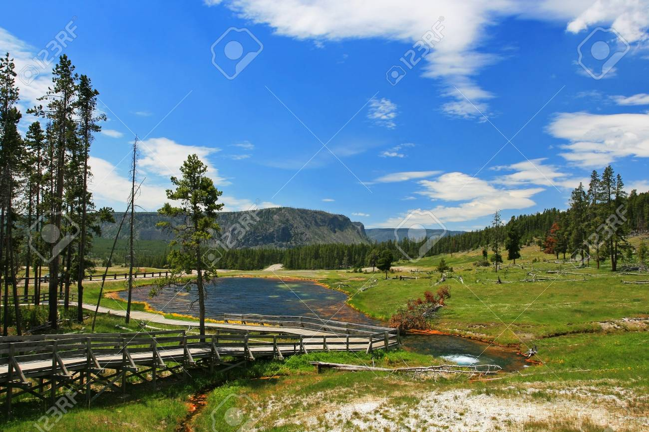 Boardwalk To Geysers With Landscape Background At Yellowstone 1300x866