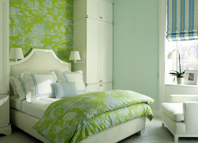 bedroom with wall covered in green toile wallpaper The bed has a 796x575
