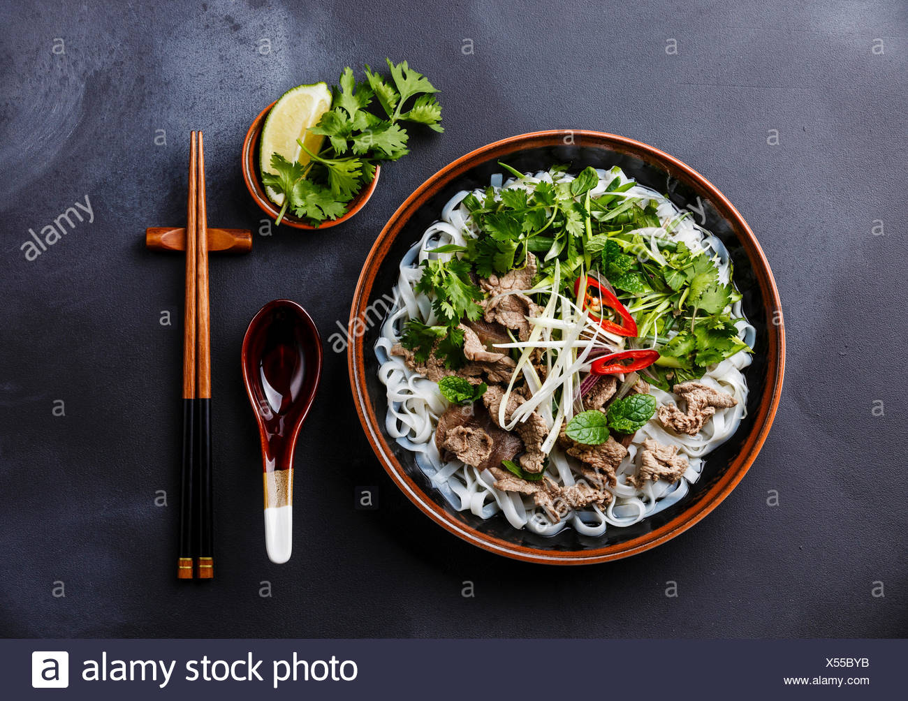 Pho Bo vietnamese Soup with beef on dark background Stock Photo 1300x1004
