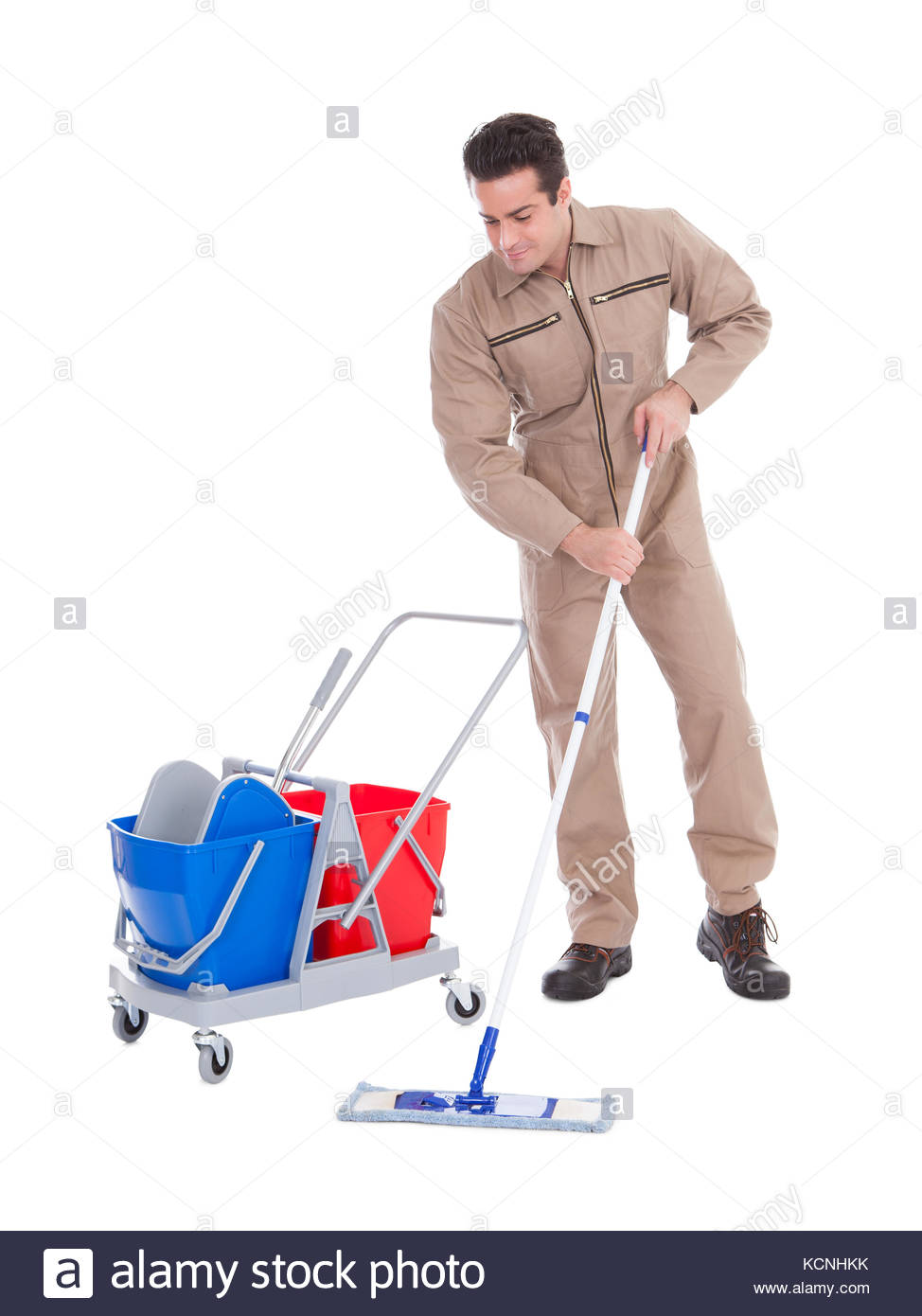 Young Male Sweeper Cleaning Floor On White Background Stock Photo 974x1390
