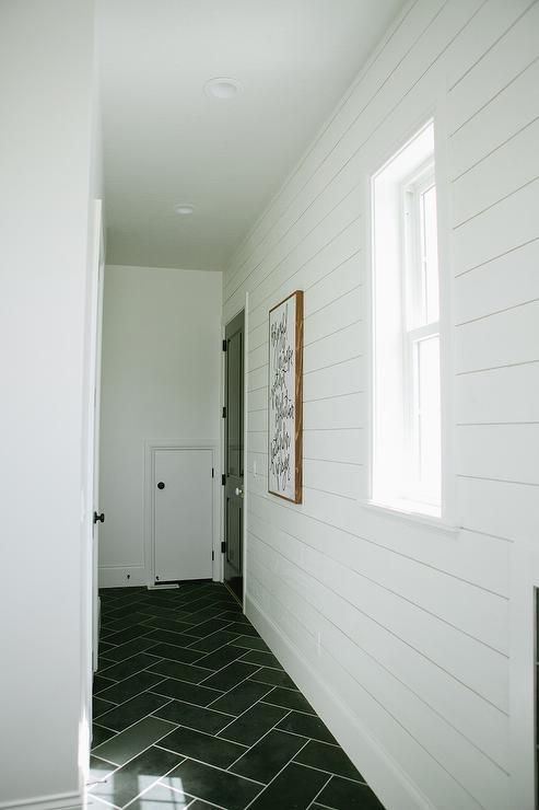 White Shiplap Mudroom with Gray Slate Herringbone Floor 493x740