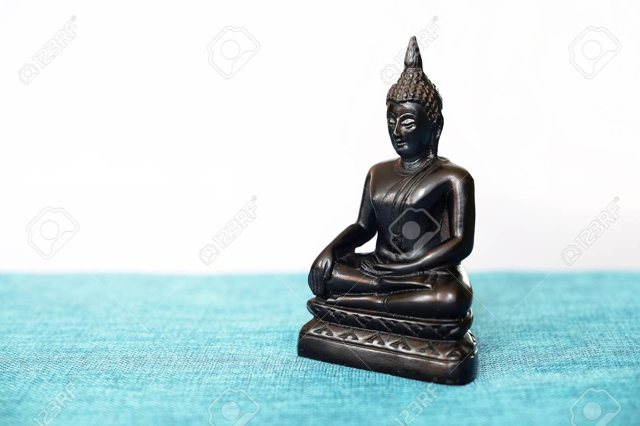 A Decorative Statue Of Buddha Buddha On The Background Of Incense 1300x866