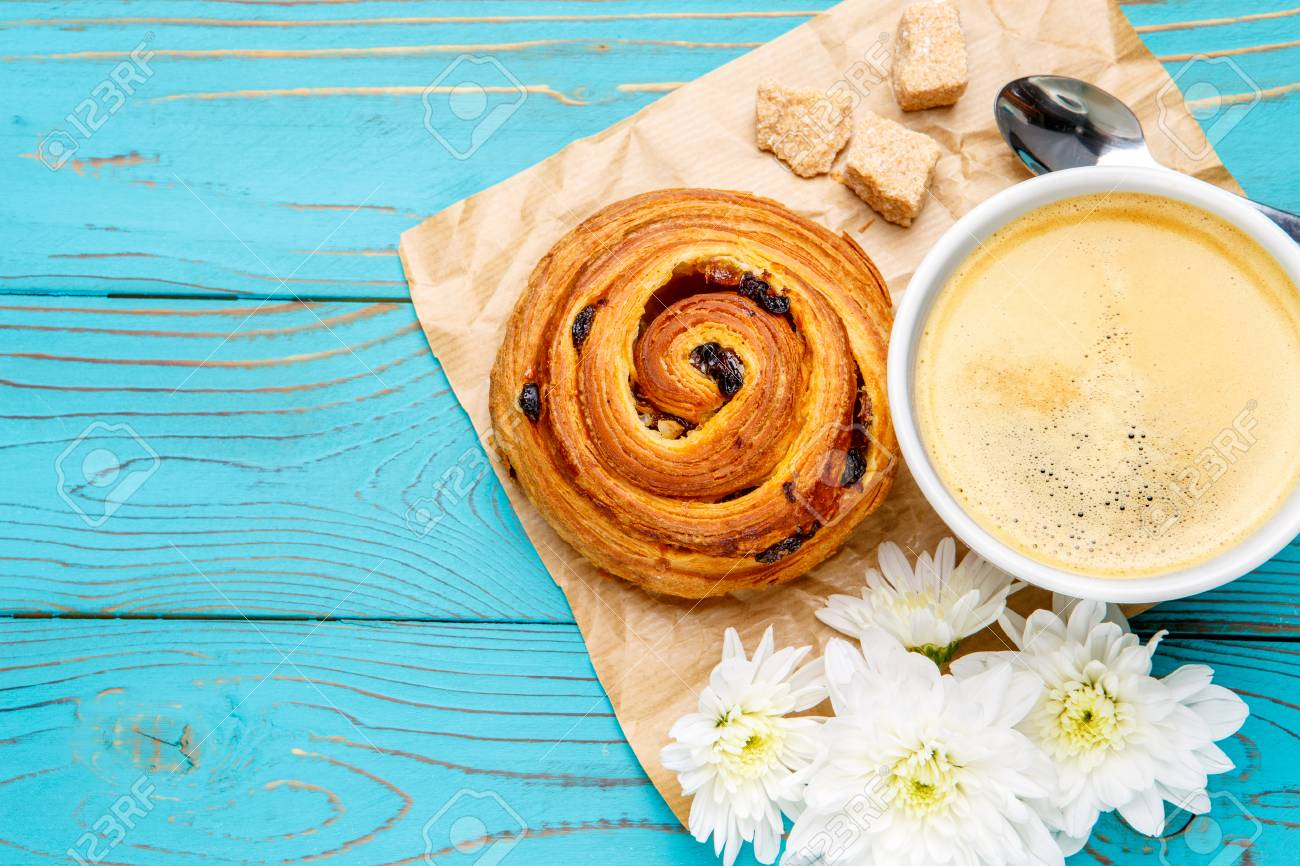 Studio Shot Of Fresh Cinnabon And Coffee On Wooden Background 1300x866