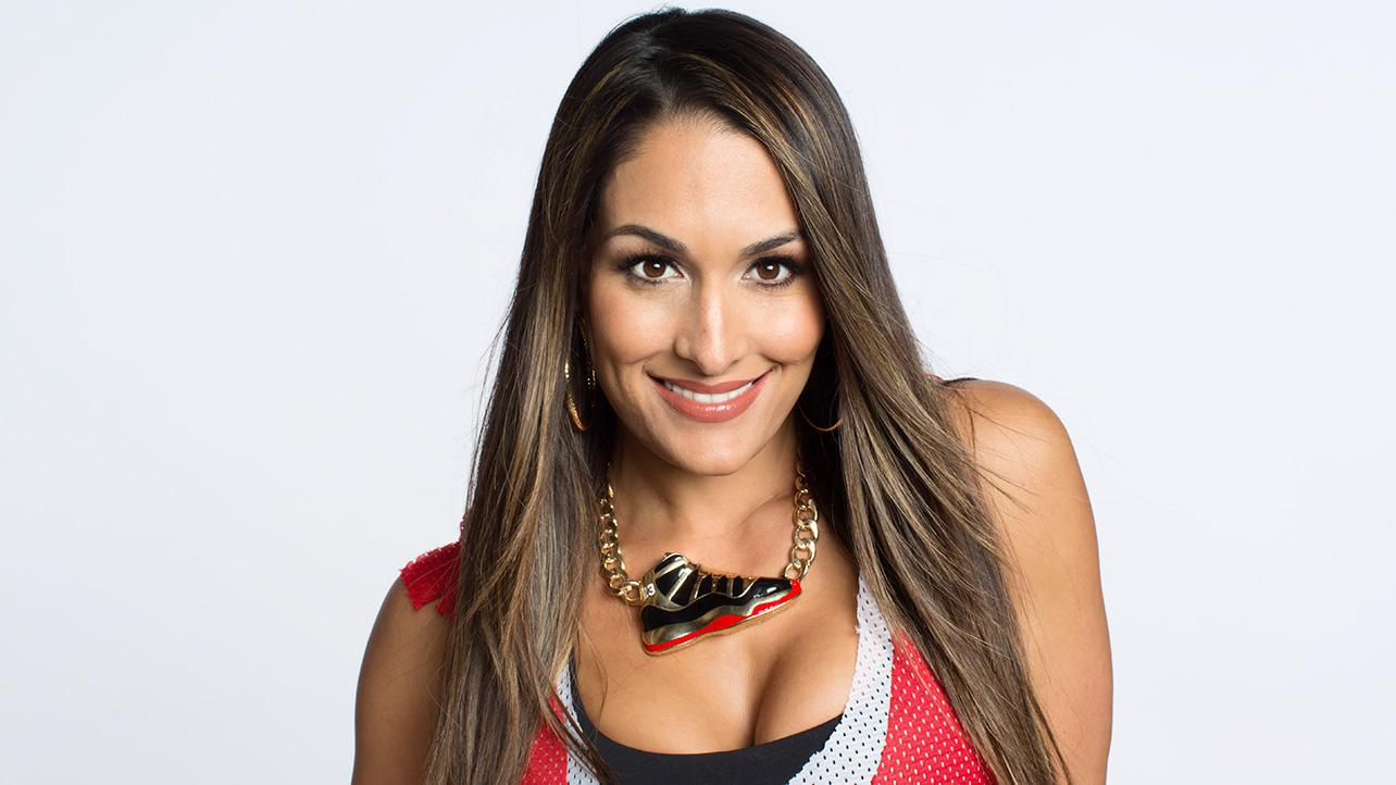 Besides her supersized breast implants WWE fans can tell Nikki Bella apart from her sister Brie through her booty! With her shapely body Nikki obviously has a