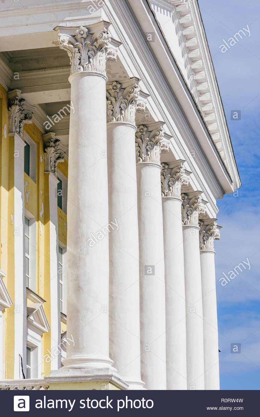Front of Old Buildig with Columns on Sky Background Alexander 867x1390