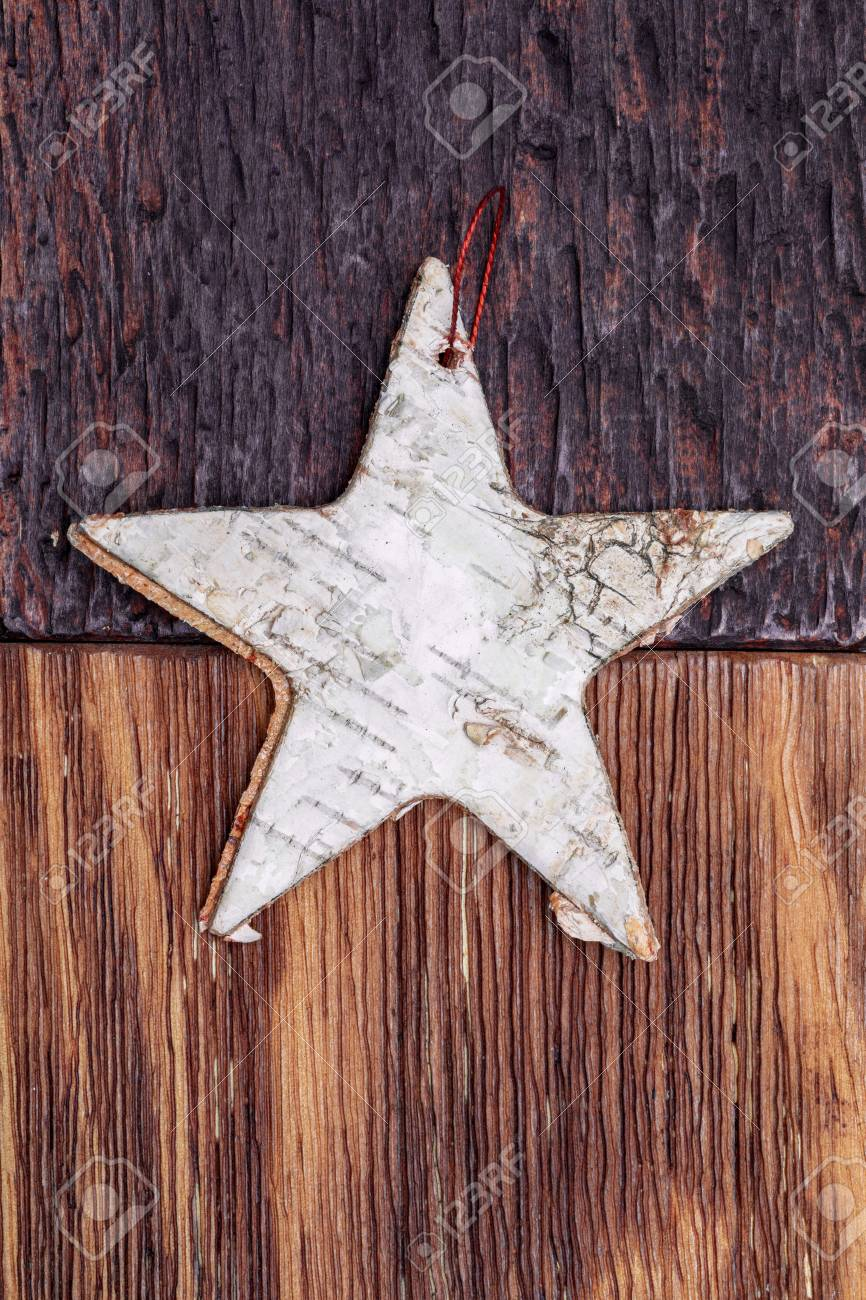 Beautiful Star Of Birch Bark On Wooden Craftsman Background light 866x1300