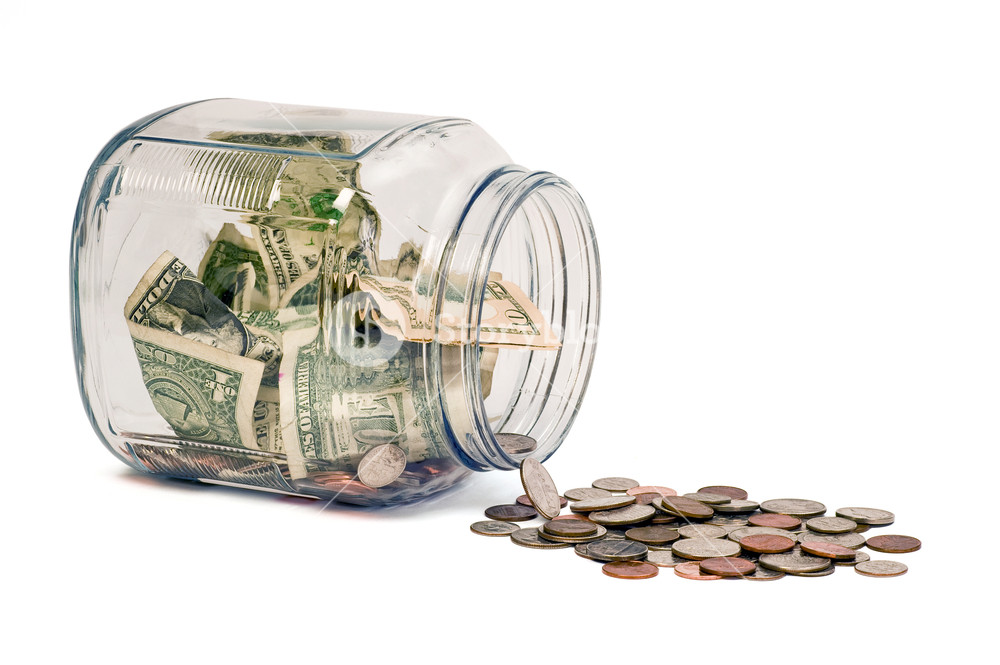 Money Jar Spill On White Background Royalty  Stock Image 1000x665