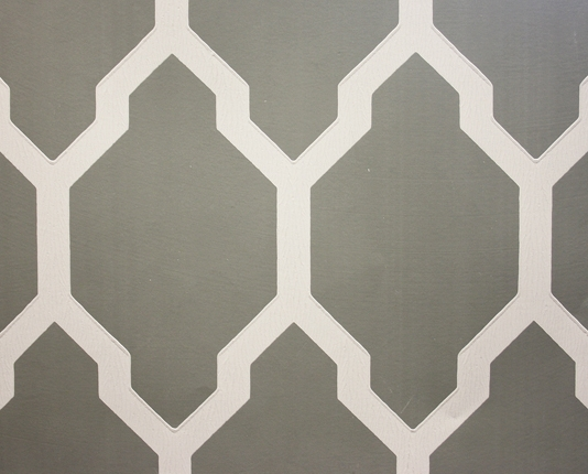 Wallpaper A large bold geometric repeat design in dark grey and white 534x430