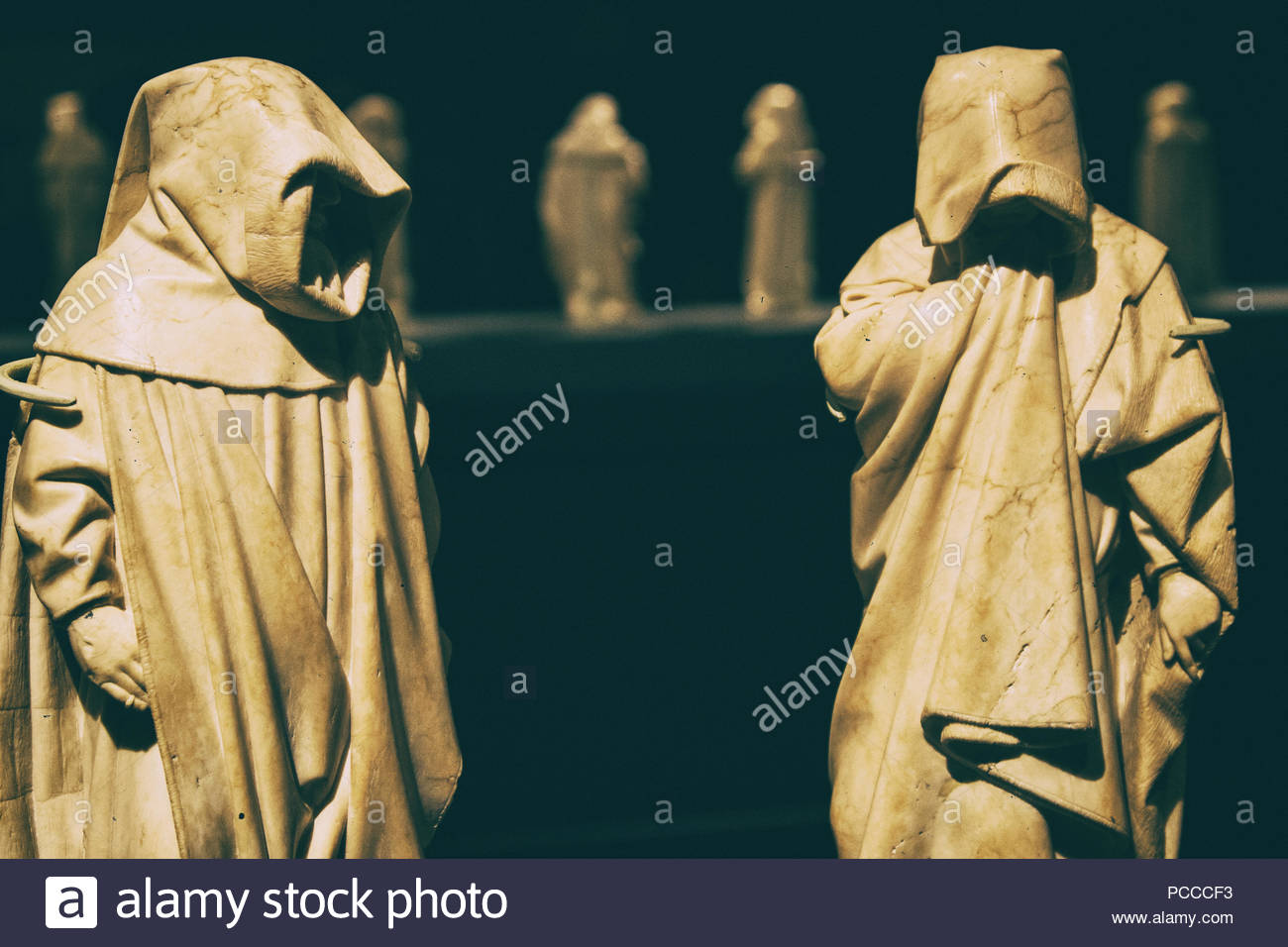 Spooky mysterious friar marble statue with face covered by the 1300x956