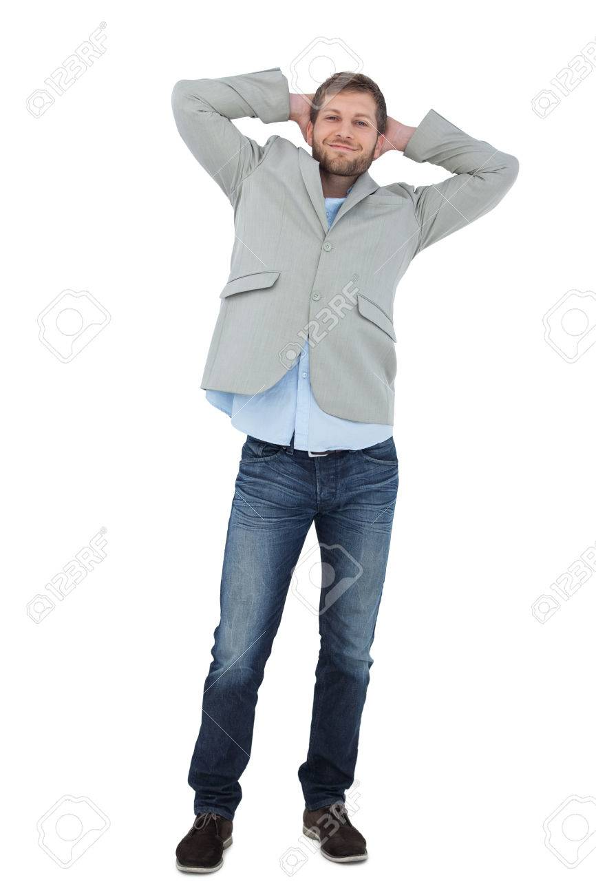 Suave Man In A Blazer With Hands Behind Head Looking At Camera 866x1300