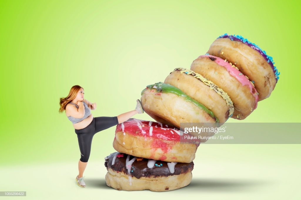 Overweight Woman Kicking Donuts Over White Background Stock Photo 1024x682